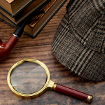 Literary fiction, police inspector, investigate crime and mystery story conceptual idea with sherlock holmes detective hat, smoking pipe, retro magnifying glass and book isolated on wood table top